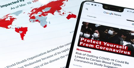 Phone and mobile screens showing news stories